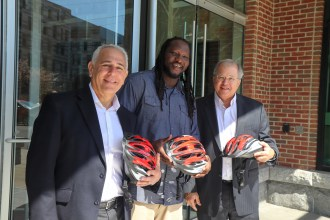 From left: Attorney Ronald E. Gluck (left) and Attorney David W. White (right) with Kessen Green, director of outreach and community programs for the Cambridge Police Department.