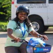 Women riding a BlueBike at the Mattapan on Wheels 2019.
