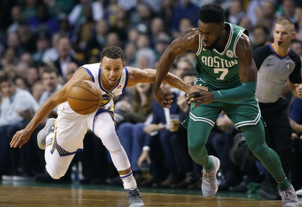 Boston Celtics' Jaylen Brown (7) and Golden State Warriors' Stephen Curry battle for a loose ball during the first quarter of an NBA basketball game in Boston, Thursday, Nov. 16, 2017. (AP Photo/Michael Dwyer)