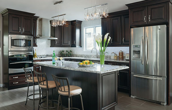 updated kitchens kitchen chairs on rollers makeovers renovation stories masterbrand family s consists of new kemper cabinets in kingston chocolate finish granite countertops