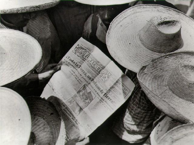 Mexican peasants reading El Machete (Tina Modotti)
