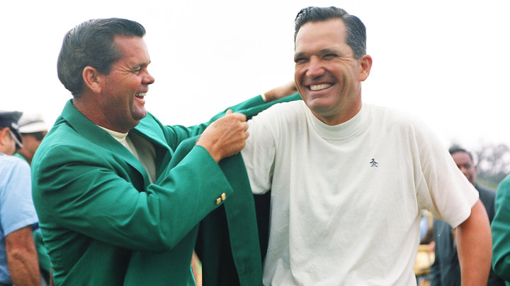 Masters champion Bob Goalby receives his Green Jacket from 1967 Masters Champion Gay Brewer at the Green Jacket Ceremony during the 1968 Masters Tournament.