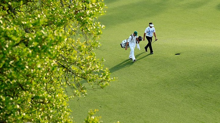 Bubba Watson walks up No. 18 fairway during the final round of the 2014 Masters.