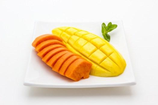 Mango and Papaya on white plate isolated on white background