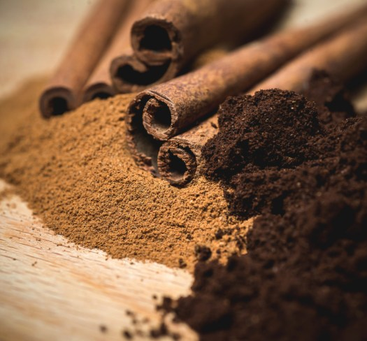 cinnamon powder with sticks and coffee powder. ** Note: Shallow depth of field