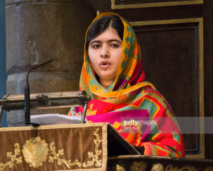 Malala delivers a speech. Photo via GettyImages