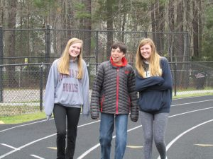 Collegiate students walk the track with their buddy.