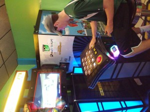 Ben Greer ('16) plays trivia in the arcade