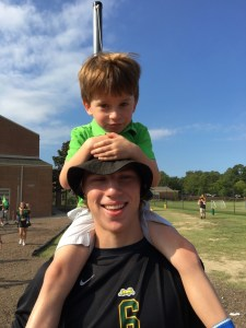 Sam Hunter ('17) with Kindergartener William