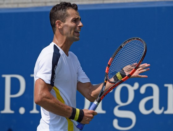 Santiago Giraldo of Colombia reacts to a point against Austin Krajicek of the US during their US Open 2015 first round men's singles match at the USTA Billie Jean King National Center September 1, 2015 in New York. AFP PHOTO/DON EMMERT
