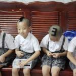 Gêmeos chineses ganham números de identificação na cabeça