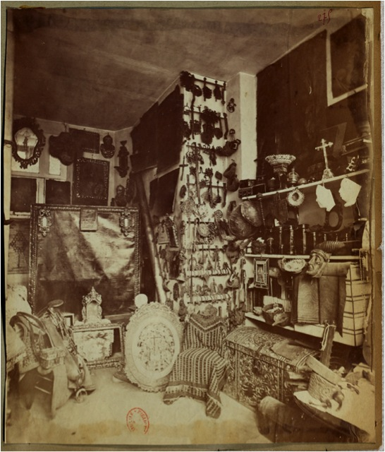 Fig. 2. A new and modern display: dust, darkness and disorder. Eugène Boban's shop (antique and curios dealer), boulevard Saint-Germain, circa 1880. © Bibliothèque Nationale de France (Manuel Charpy).
