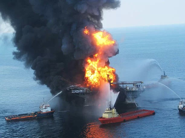 GULF OF MEXICO - APRIL 21: Fire boats battle a fire at the off shore oil rig Deepwater Horizon April 21, 2010 in the Gulf of Mexico off the coast of Louisiana. Multiple Coast Guard helicopters, planes and cutters responded to rescue the Deepwater Horizons 126 person crew after an explosion and fire caused the crew to evacuate.