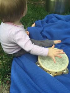 baby with tamborine