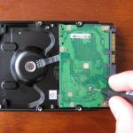 Board being screwed off hard disk