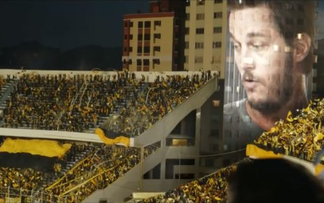 Travis Fimmel's image projected onto a stadium