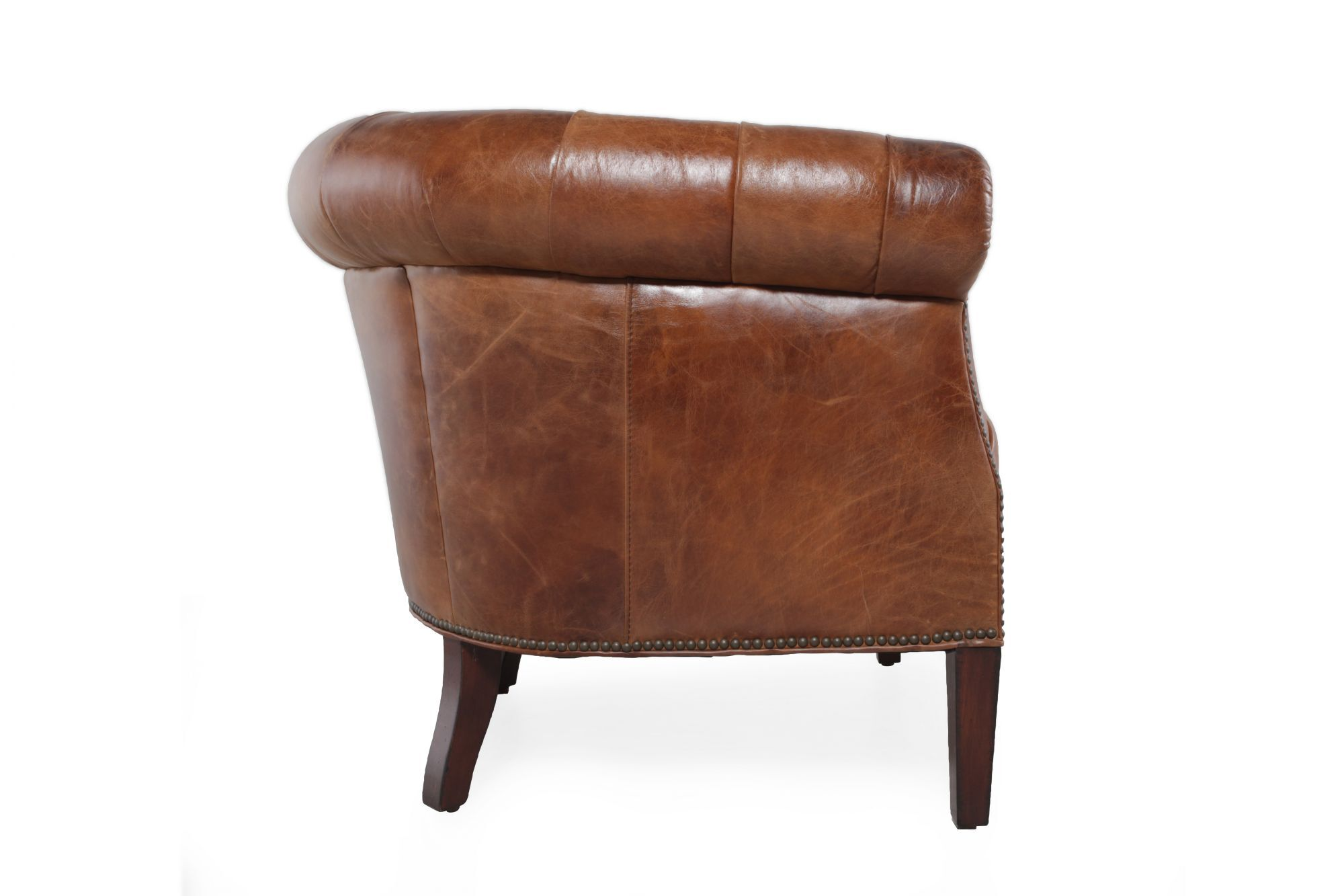 brown leather tub chair with footstool swing replacement button tufted in chestnut mathis brothers