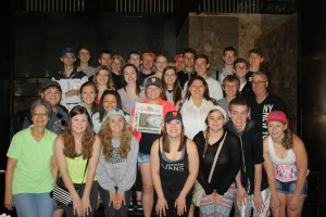 Chamber Singers hold Hays Daily News Paper dated June 16, 2014