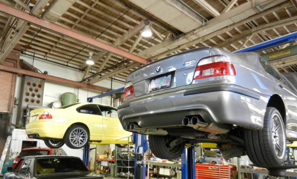 E46 BMW M3 and E39 BMW M5 in shop for diagnosis by BMW Master technician