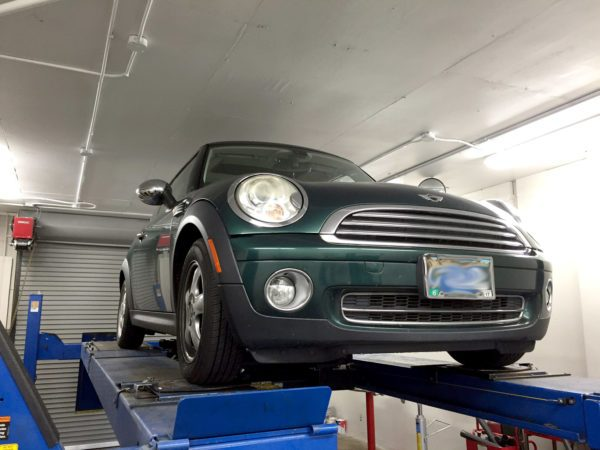 MINI Cooper on vehicle lift for diagnosis by ex-dealership technicians