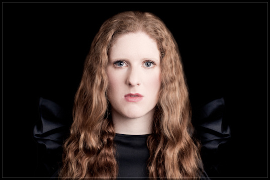 Cheryl Frances-Hoad BASCA British Composer 2010 Award winner, headshot on black