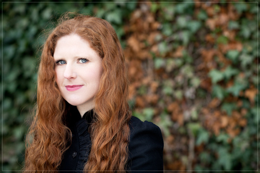 Cheryl Frances-Hoad BASCA British Composer 2010 Award winner, headshot on ivy backdrop