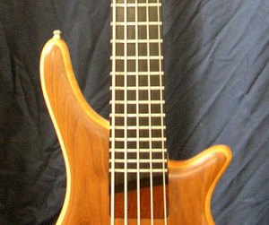 Close-up of five string bass guitar