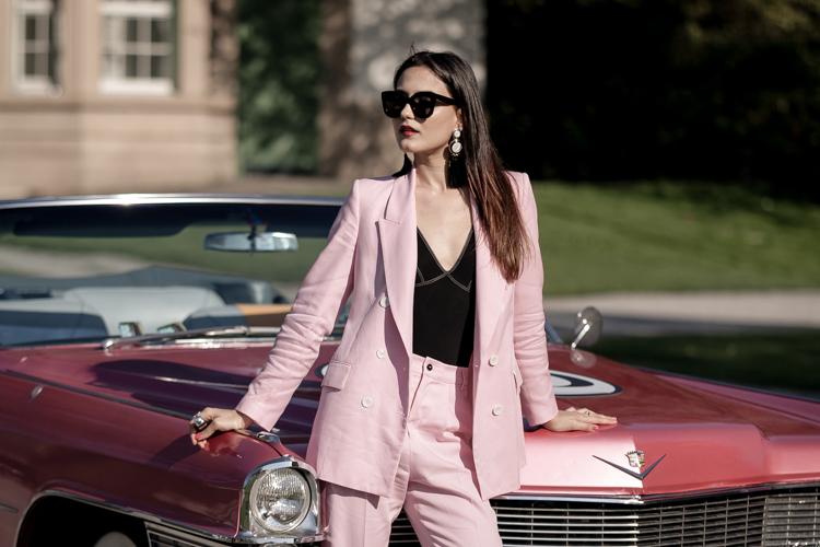 Sindia Rifi at Lake Zurich in front of a pink Cadillac
