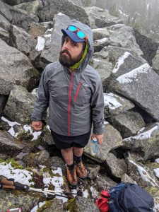 At lunch time in the boulder field. Notice the fresh snow. Notice my hope for sunglasses weather. PC: Chenmin Liu