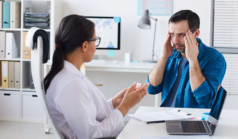 Patient discussing anxiety with his doctor. what is the ideal cbd dosage for anxiety?