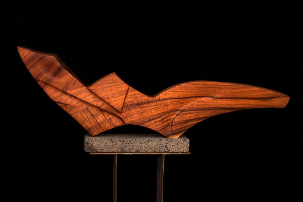 photo of Reclining Form, wood sculpture by Tim Garcia