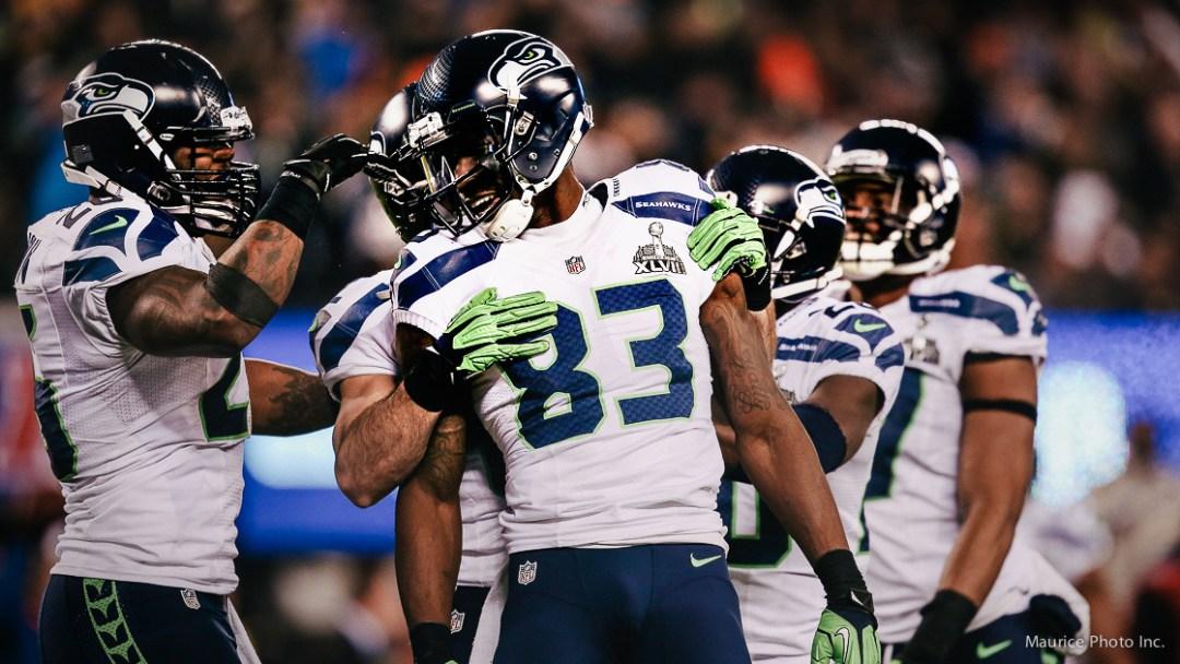 Seahawks celebrate on the field