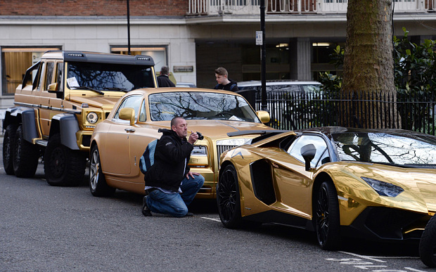 Three gold cars from Saudi Arabia (left-right) a 6x6 Mercedes G 63, Rolls-Royce Phantom Coupe and Lamborghini Aventador have received parking tickets on Cadogan Place in Knightsbridge, London. PRESS ASSOCIATION Photo. Picture date: Wednesday March 30, 2016. See PA story TRANSPORT Knightsbridge. Photo credit should read: Stefan Rousseau/PA Wire