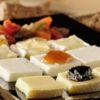 Sequencia de queijos finos com geléia e pequena caponata Restaurante Fricco Chef Sauro Scarabotta