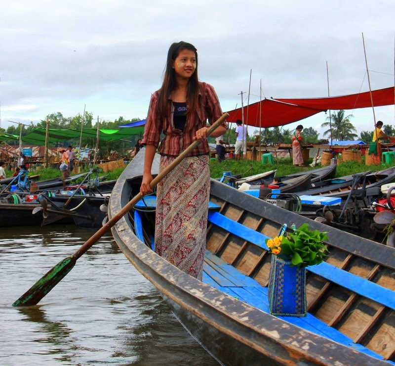 Girl rowing boat to visit lake inle weekly markets