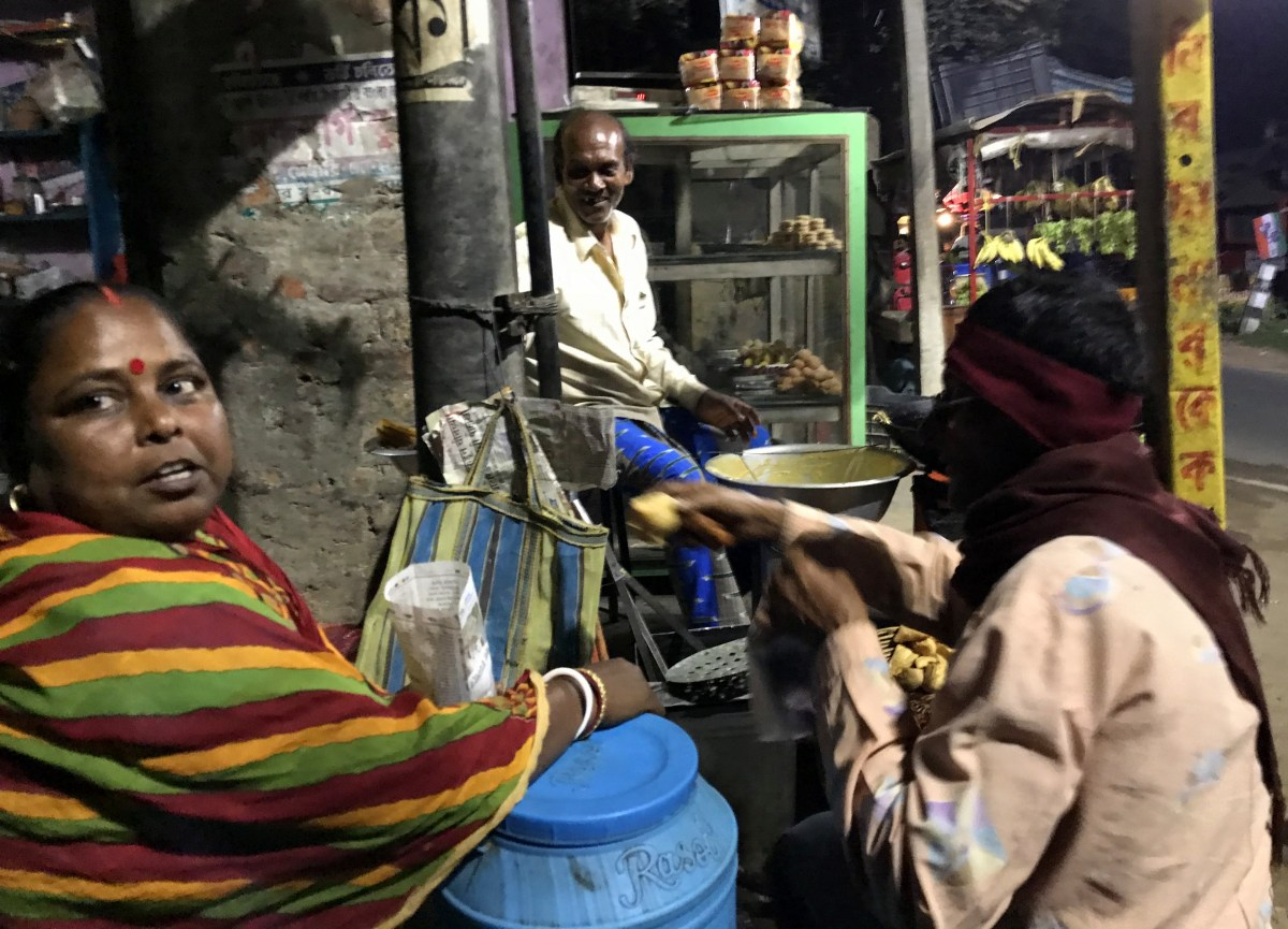 woman selling snacks at bengal village