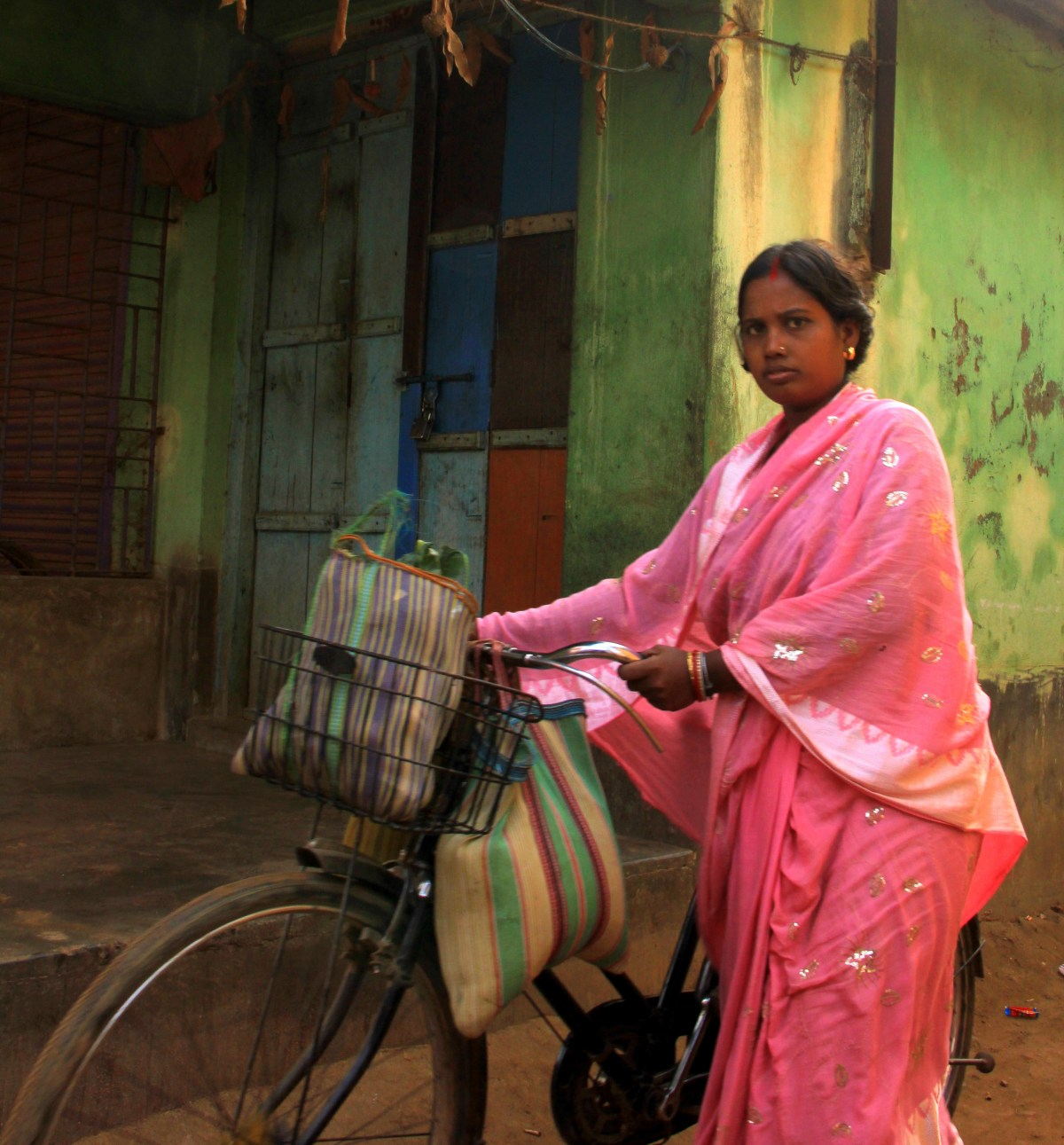 Village woman cycling in Amadpur