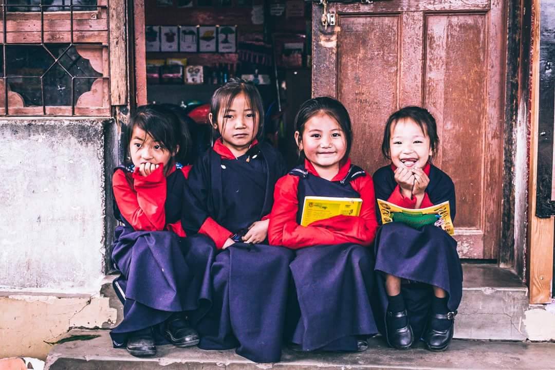 Happy children of Bhutan posing in Paro