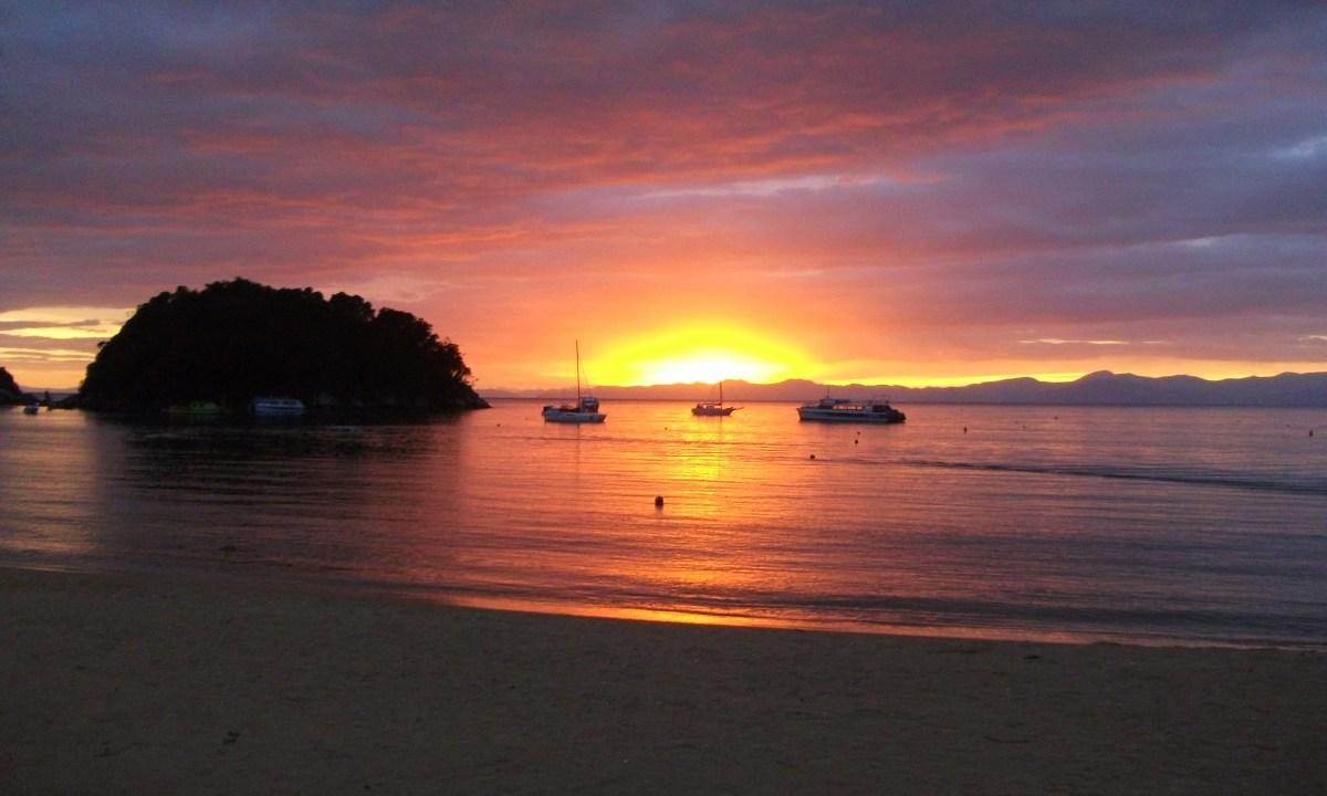 a sunset at a beach near christchurch