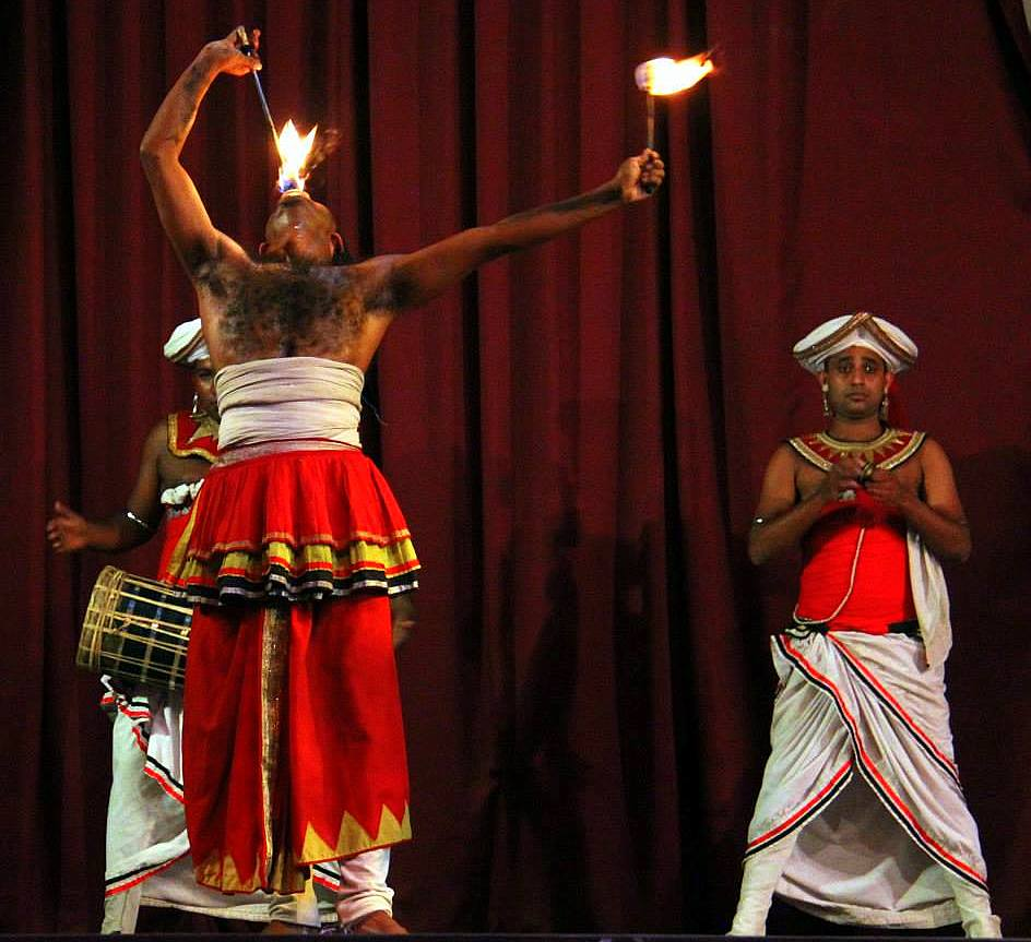 The fire-eater at the dance show in Kandy
