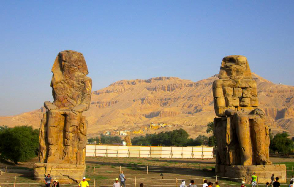 The Colossi of Memnon are two massive stone statues of the Pharaoh Amenhotep III