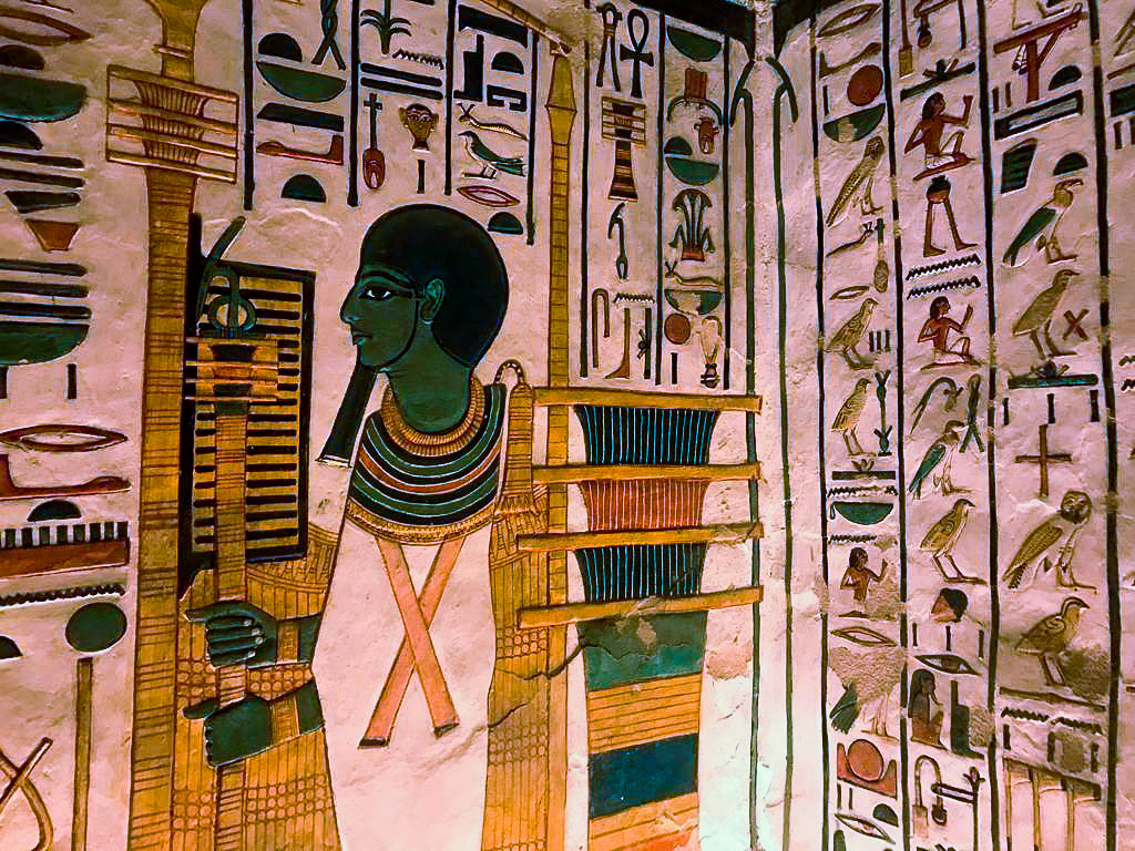 Frescoes inside the tomb of Nefertari - one guard is pacing back and forth.