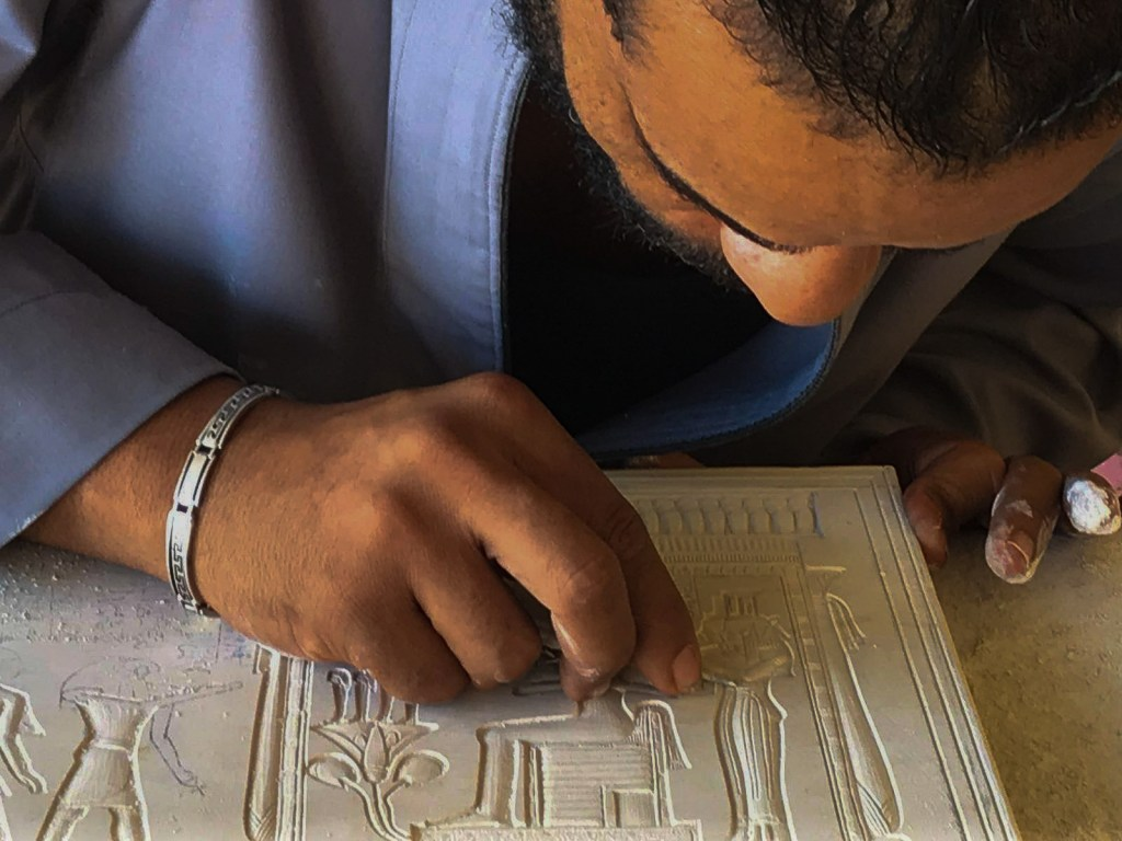 An alabaster artisan at a workshop in Luxor West Bank