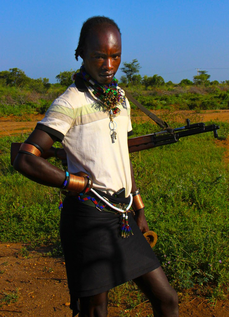 A Hamar man with his assault weapon during Omo Valley travel