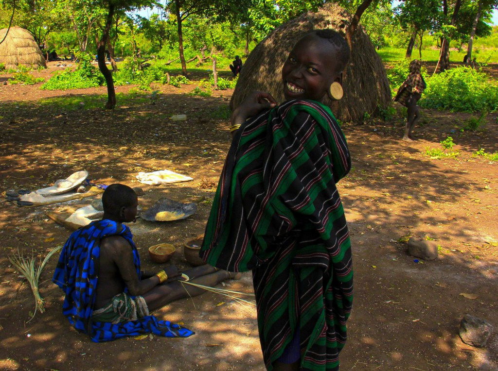 A laughing little Mursi boy during omo valley travel