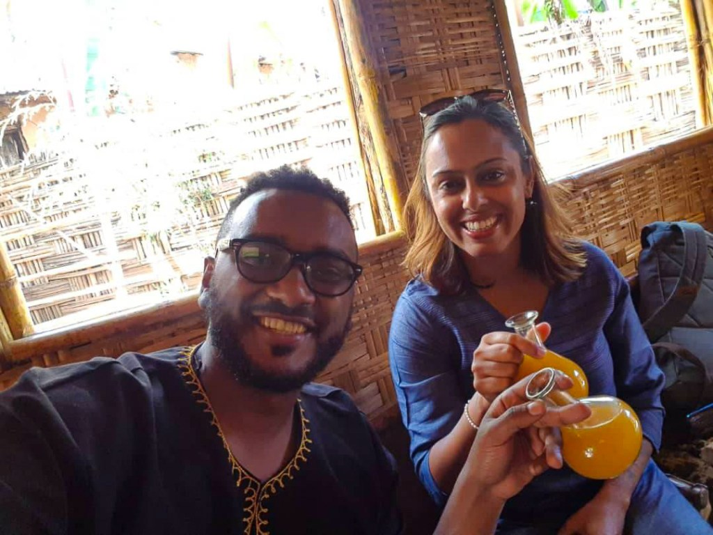 Enjoying Tej (honey wine) in Addis Ababa during my Ethiopia trip