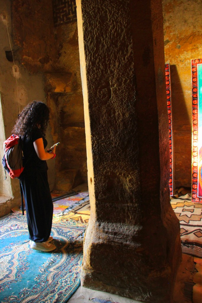 A visitor at Wukro Churkos, one of Tigray rock-cut churches