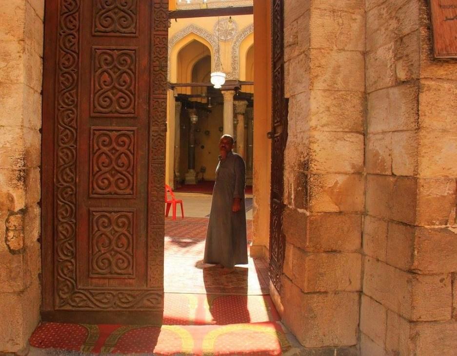 A man inside the Al Aqmar Mosque in Muizz Street