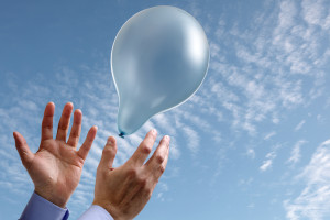 Releasing a balloon into the air concept for dreams and aspirati