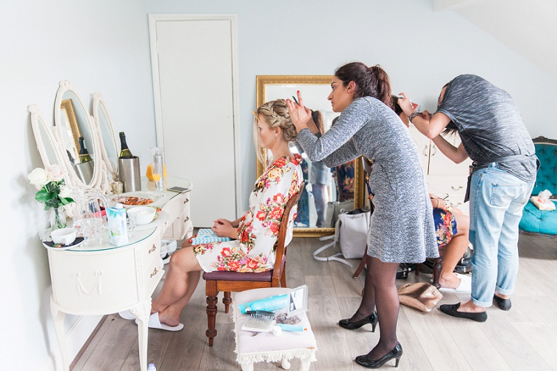 Bride and bridesmaid getting ready at Belair House